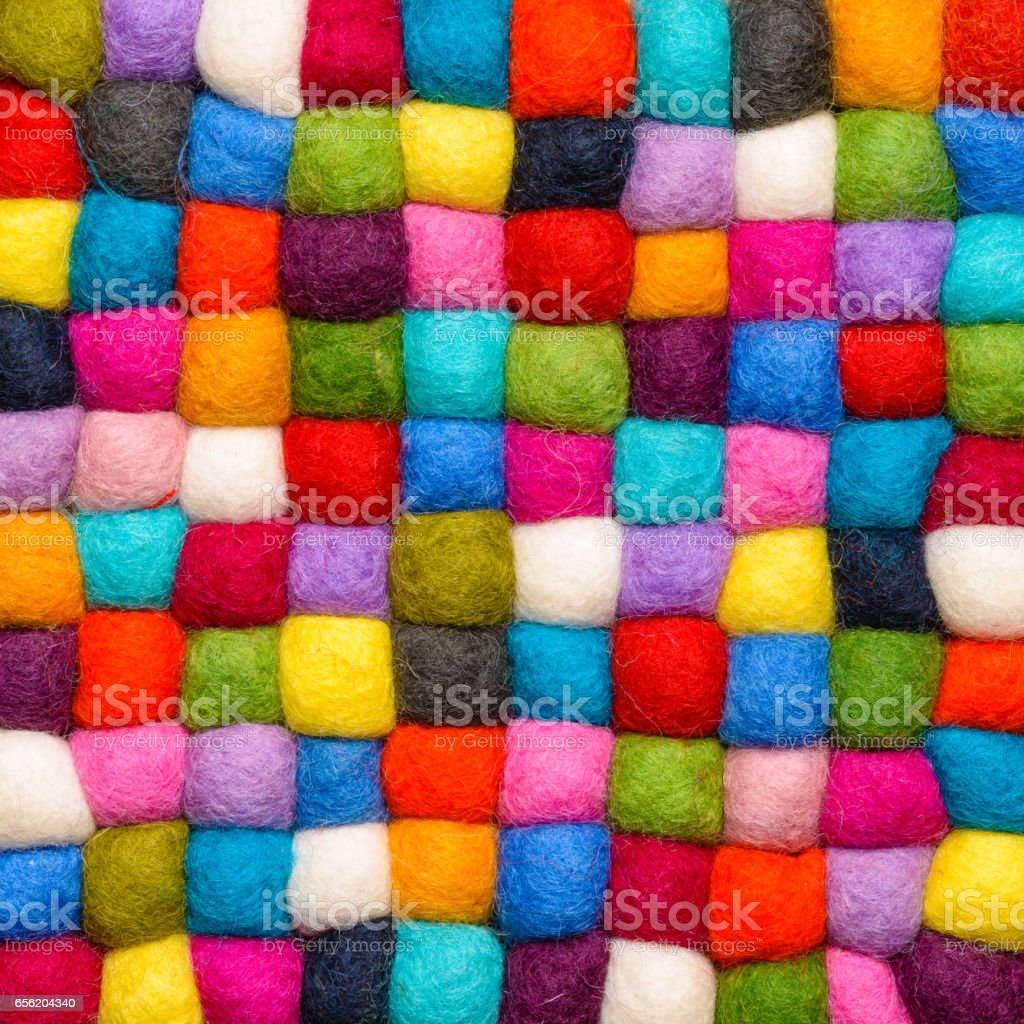 color wool background - balls of synthetic wool yarn - geometric rainbow pattern stock photo