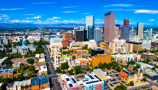 Colorful Skyline downtown Cityscape of Denver , Colorado , USA road to the Colorado State Capitol building and Rocky Mountains