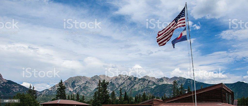 Colorado Flag American Flag Rocky Mountain Landscape stock photo