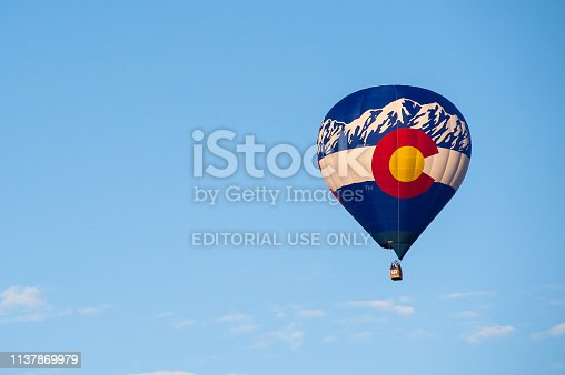 A hot air balloon with the design of the Colorado state flag