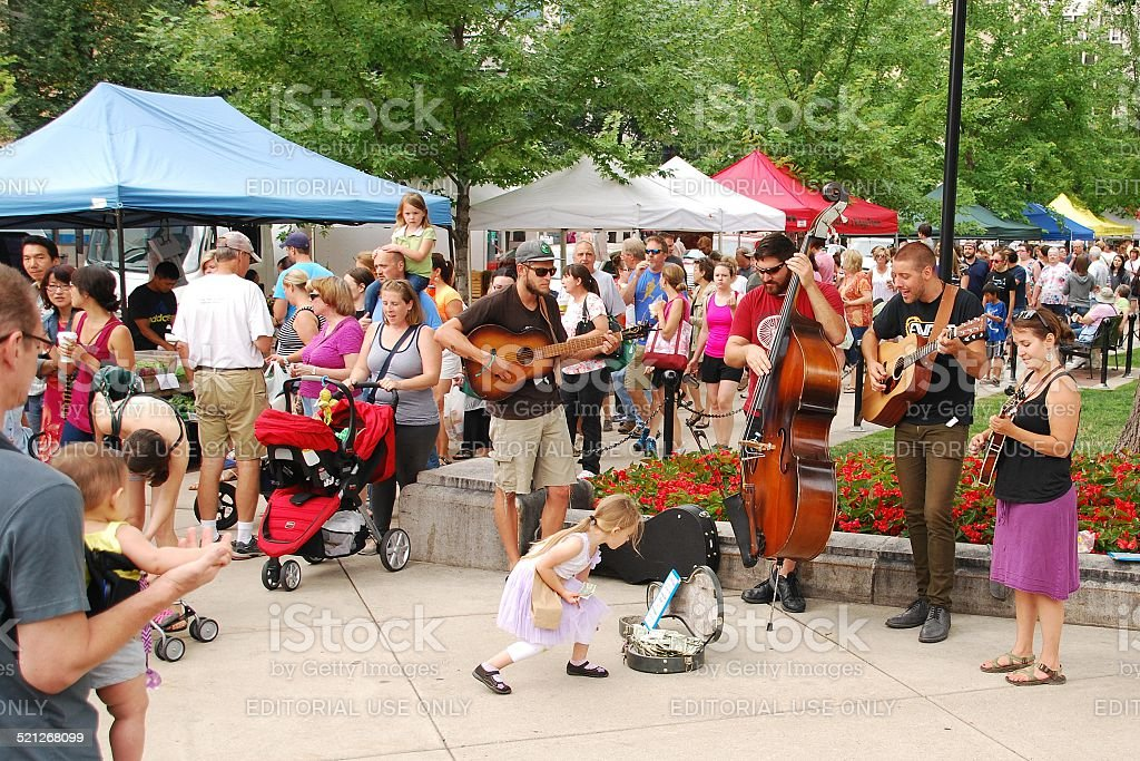"Colorado Folk Music at the Madison Farmer's Market Madison, WI, USA - July 26, 2014: Colorado music act ""Rich With Friends"" performs outside the Wisconsin State Capitol building during a regular Saturday Farmer's Market. 2014 Stock Photo"