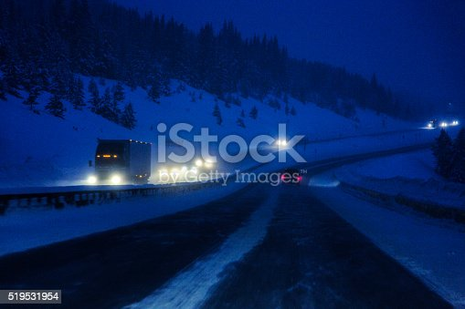 1127834626 istock photo Colorado Interstate 70 Rocky Mountains Snow Blizzard Night Traffic 519531954