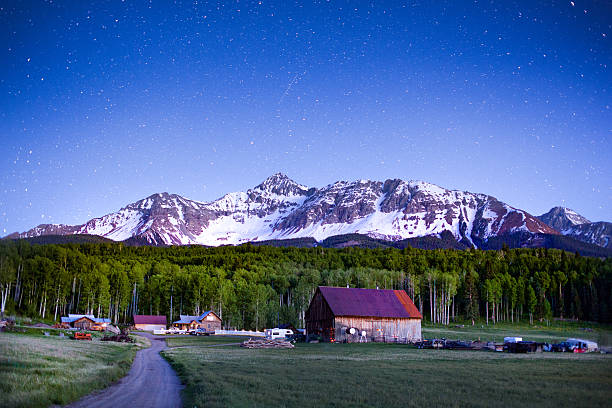 Colorado Mountain Ranch Ranch at the foot of Wilson Peak in southwest Colorado near Telluride at night with stars in the sky Creativecontentbrief 603439743 san juan mountains stock pictures, royalty-free photos & images