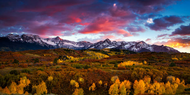 Colorado Mountains at Autumn Vibrant skies at sunset over the Dallas Divide in Colorado's San Juan Mountains san juan mountains stock pictures, royalty-free photos & images