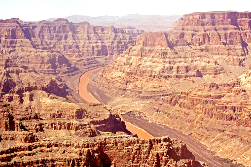 Colorado river at Grand Canyon national park, Arizona. Valley view from above. Breathtaking rock formation and cliffs.