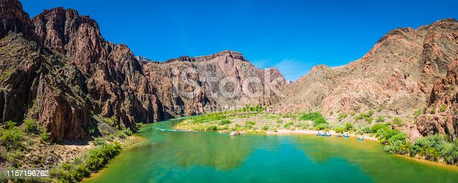 Group of rafters on inflatable boats on the banks of the Colorado River through the Inner Canyon past Phantom Ranch in the heart of the Grand Canyon National Park, Arizona, USA.