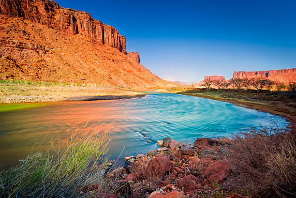 Colorado River in Utah Late afternoon long exposure view of a colorful bend in the colorado River outside Moab, UT colorado river stock pictures, royalty-free photos & images