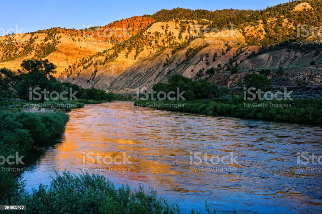Colorado River Reflections in Water Colorado River Reflections in Water - Scenic nature landscape images in rugged canyon. Color Image Stock Photo