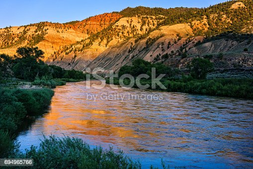 Colorado River Reflections in Water - Scenic nature landscape images in rugged canyon.