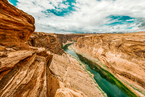 Dramatic landscape at the Grand Canyon National Park where the Colorado River runs through rock formations of eroded sand stone.