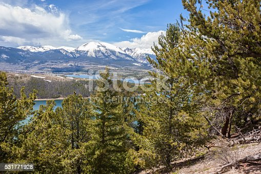 snow covered peaks are a backdrop for the colorado mountain landscape near dillon reservoir in summit county colorado in spring