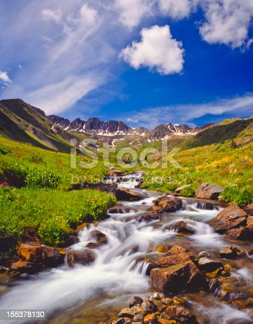 Alpine meadow with rushing stream in The Rocky Mountains of Colorado