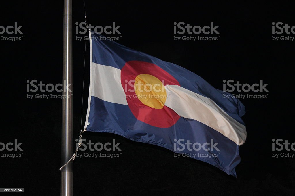 Colorado State Flag in the Wind at Night stock photo