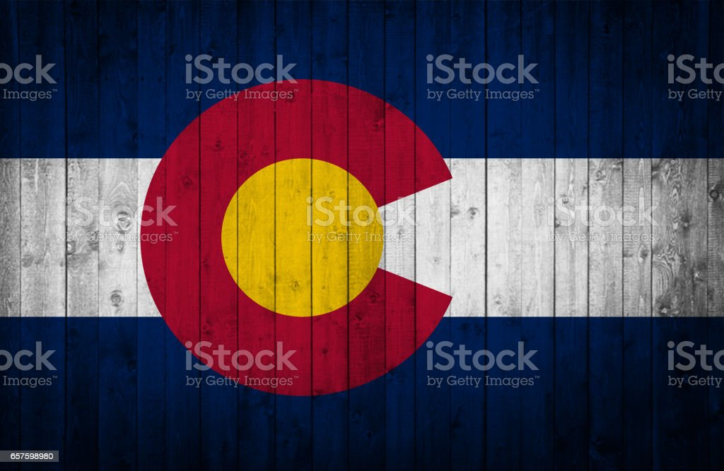 Colorado State flag is painted on a wooden surface stock photo