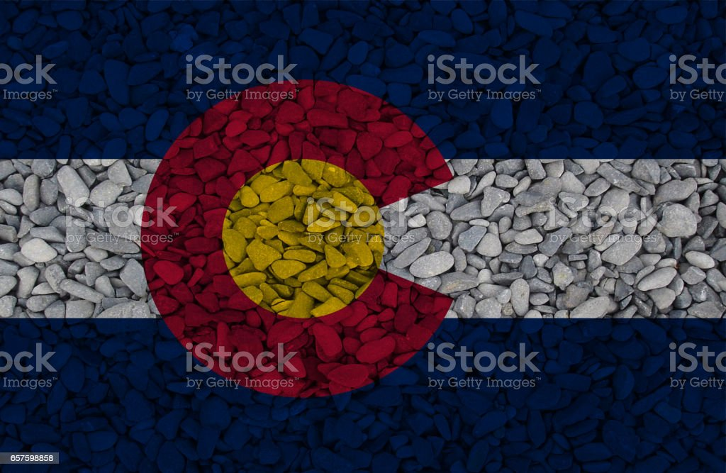 Colorado State flag painted on stones in nature stock photo
