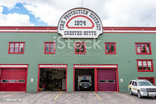 Crested Butte, USA - June 21, 2019: Colorado village downtown in summer with fire protection district building garage and trucks