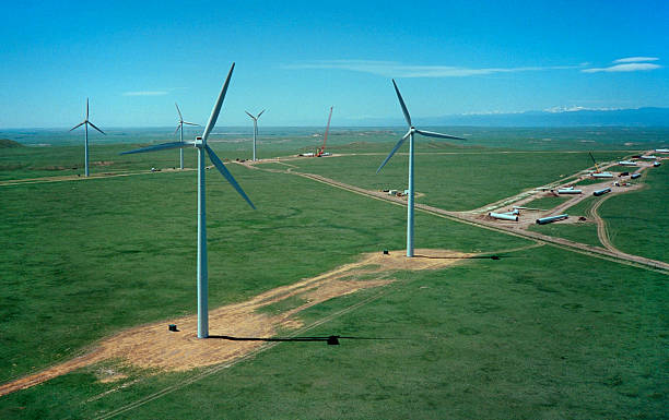 Colorado wind farm construction with Rocky Mountains stock photo