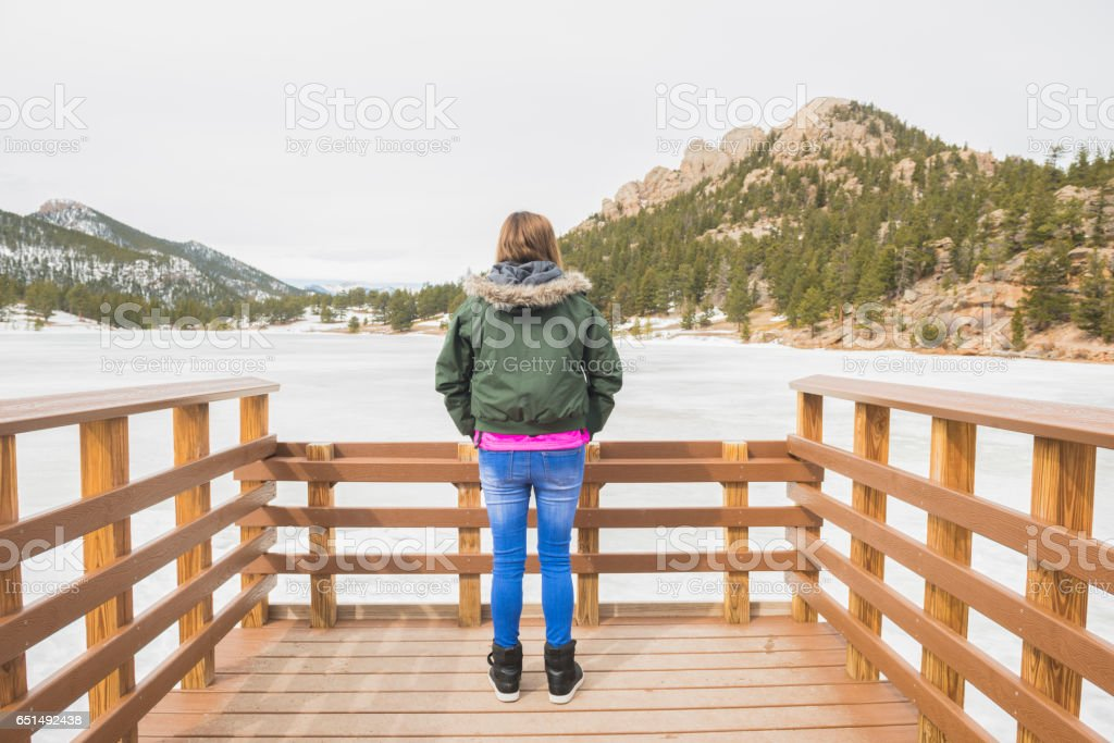 Colorado Woman in Rocky Mountain National Park Winter stock photo