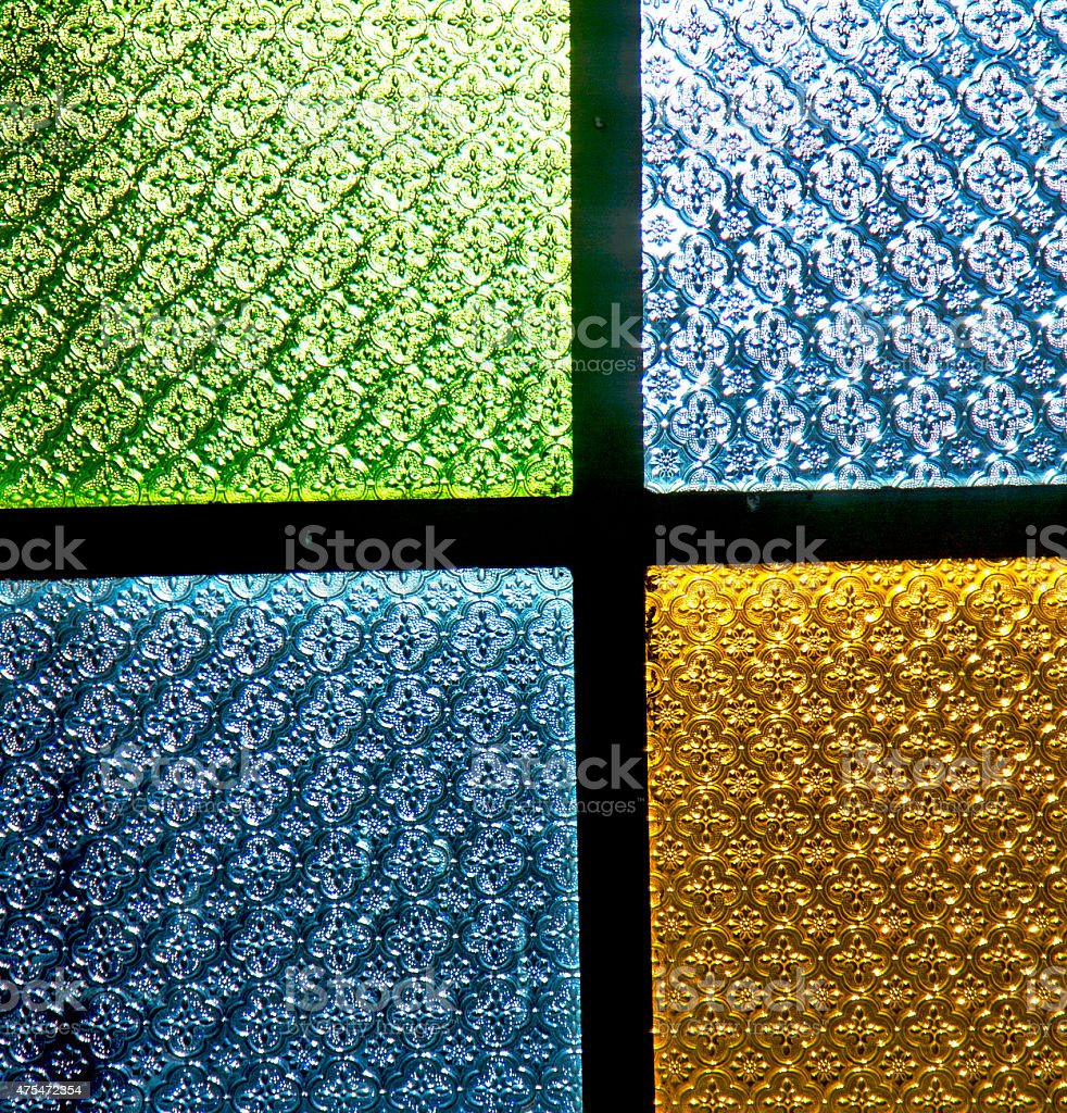 colorated glass and sun in morocco africa window and light stock photo