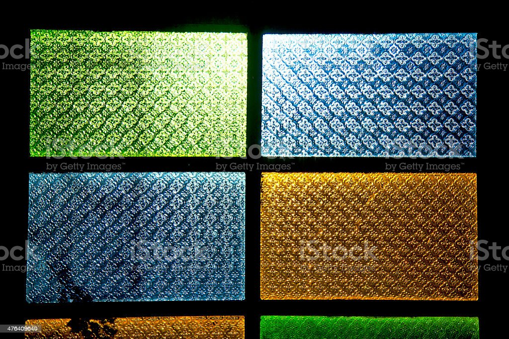 colorated glass  sun in   window and light stock photo