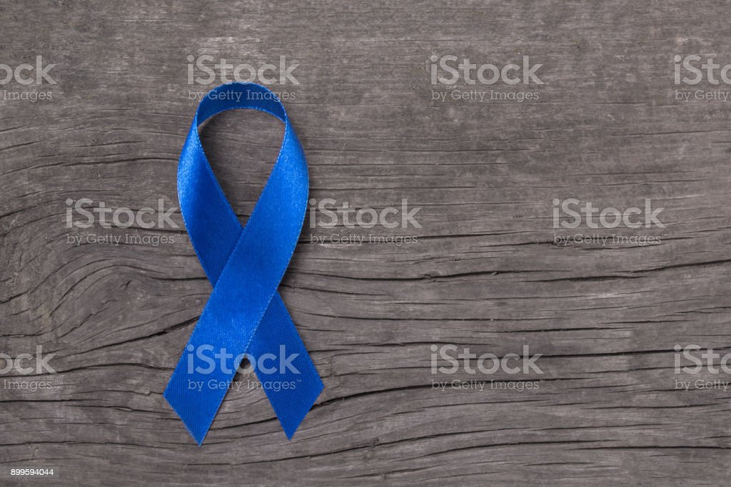 Colorectal/ Colon cancer, Acute Respiratory Distress Syndrome (ARDS), and Tuberous Sclerosis awareness symbolic with dark blue ribbon stock photo