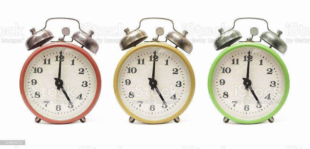 colored alarm clocks isolated royalty-free stock photo
