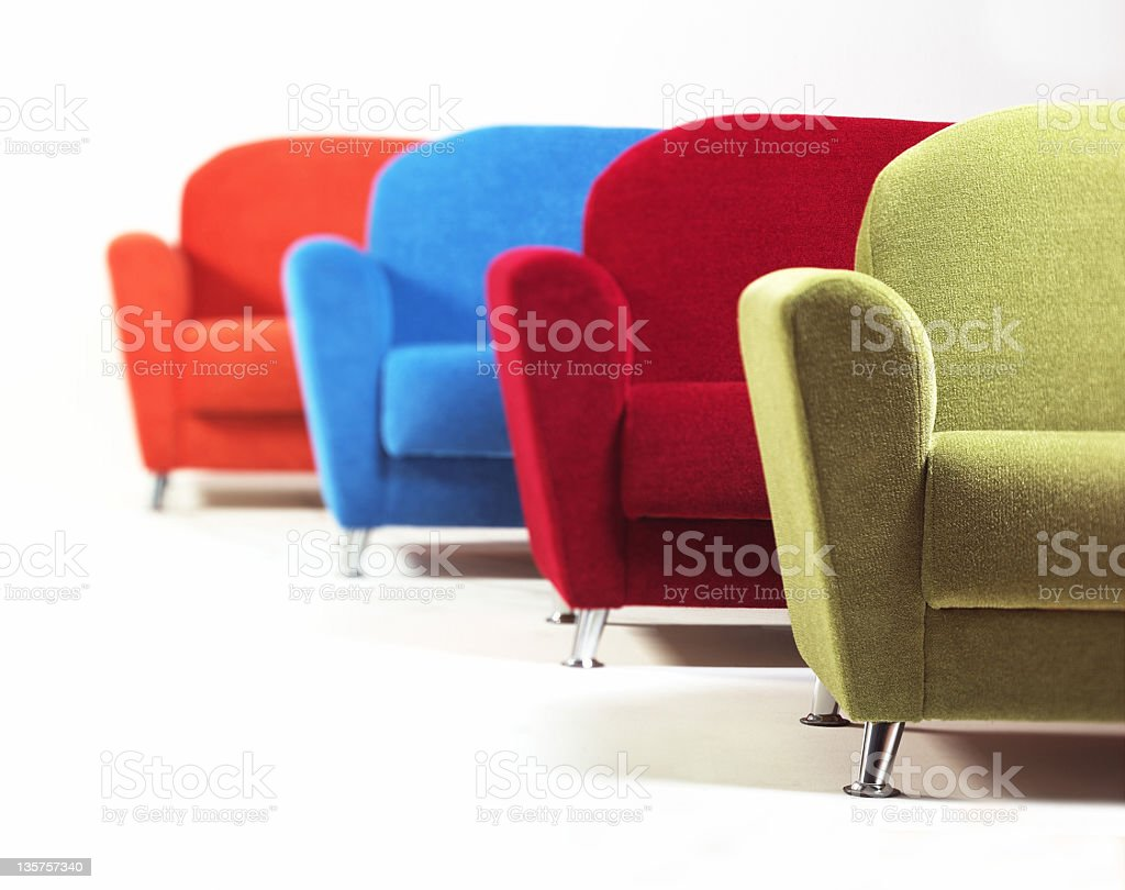 colored armchairs stock photo