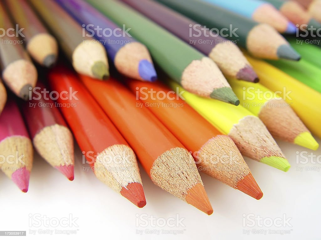 Colored art pencils close up against white royalty-free stock photo