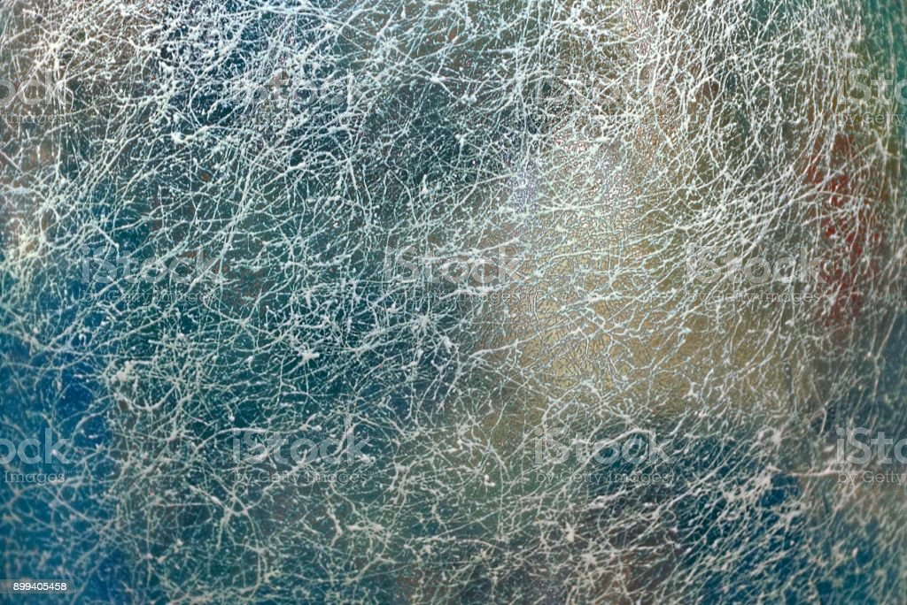 colored background of grated turbid glass in cracks stock photo