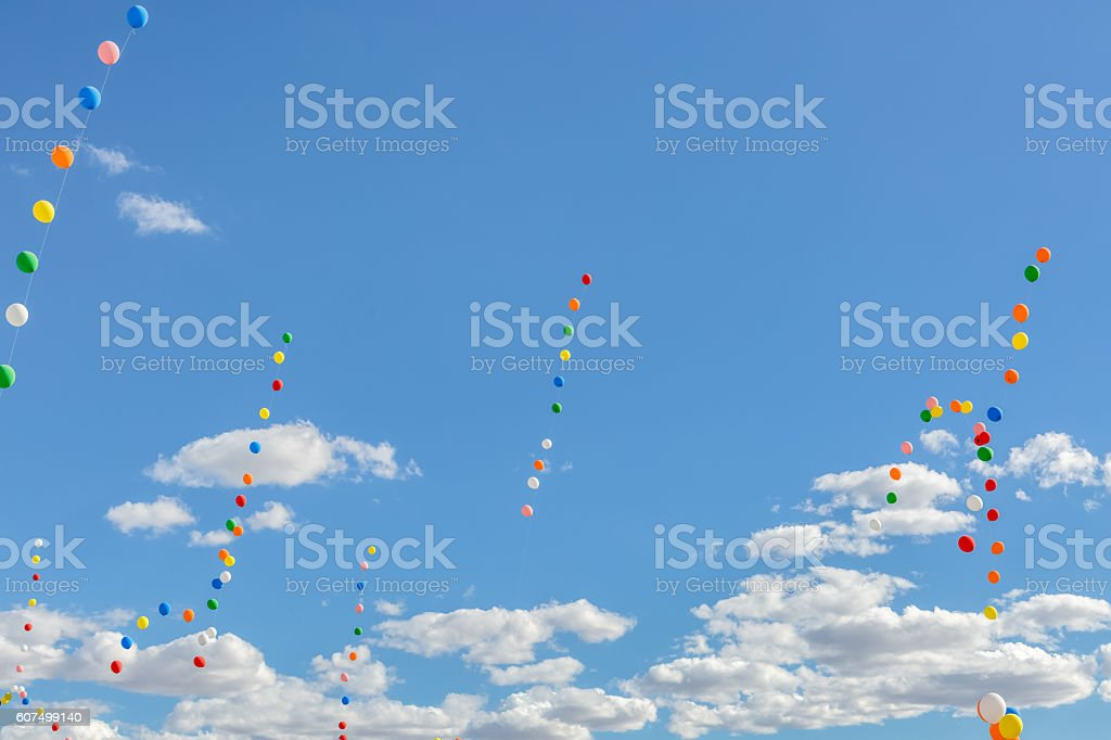 Colored Balloons In Blue Sky With White Fluffy Clouds royalty-free stock photo