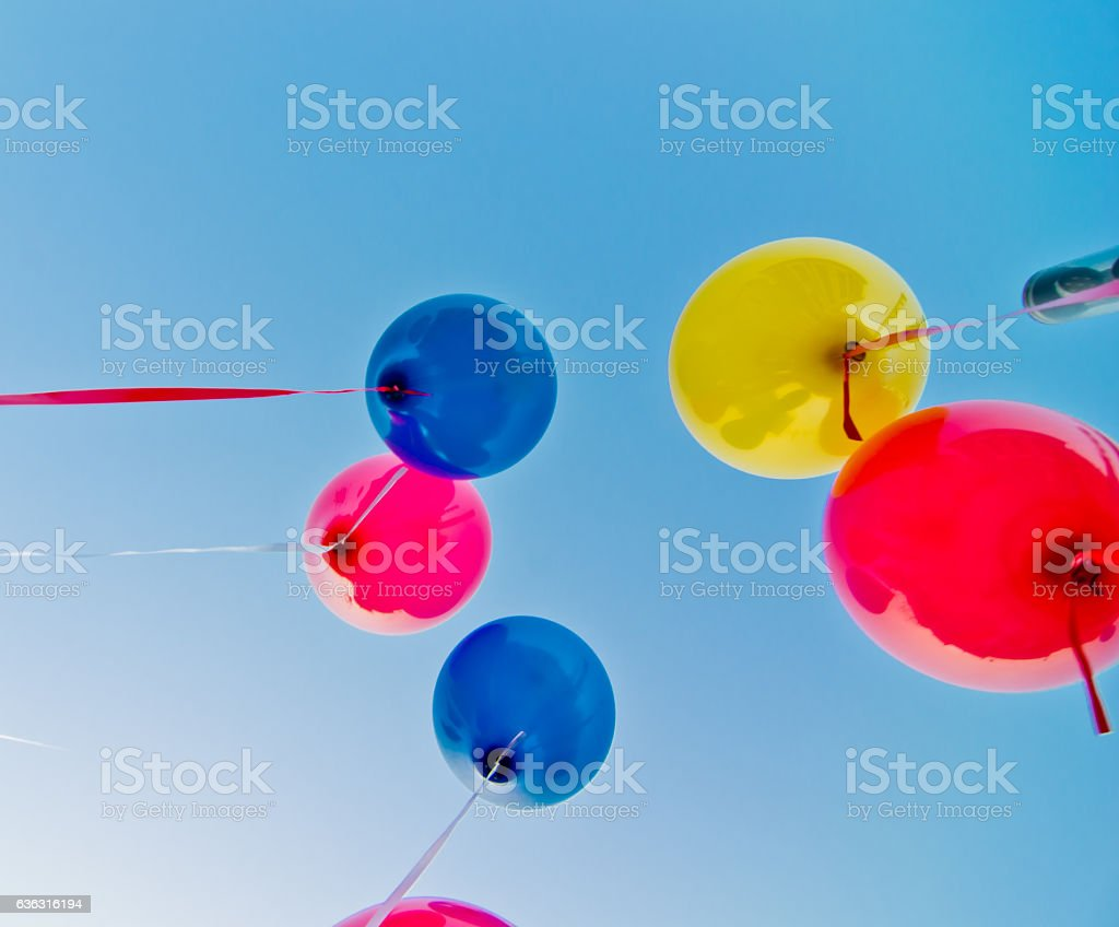 colored balloons in the blue sky stock photo