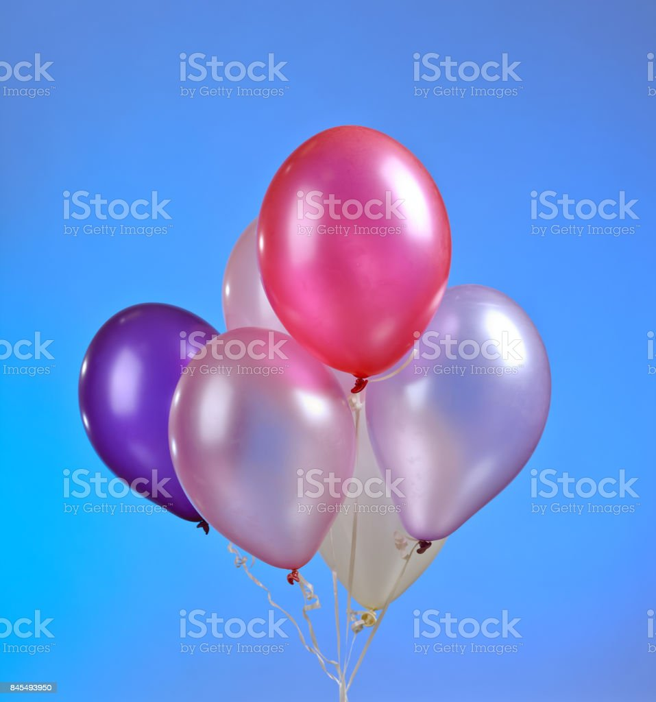 colored balloons on a blue background stock photo