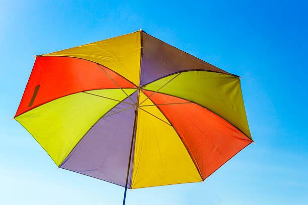 Colored beach umbrella stock photo