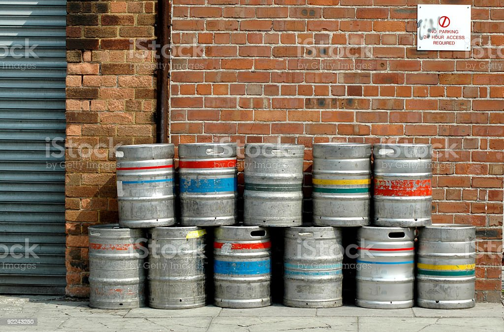Colored beer barrel outside a pub stock photo