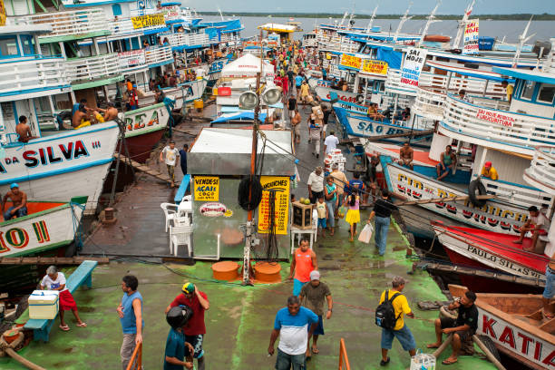 Colored boats in Manaus harbor - Amazon stock photo