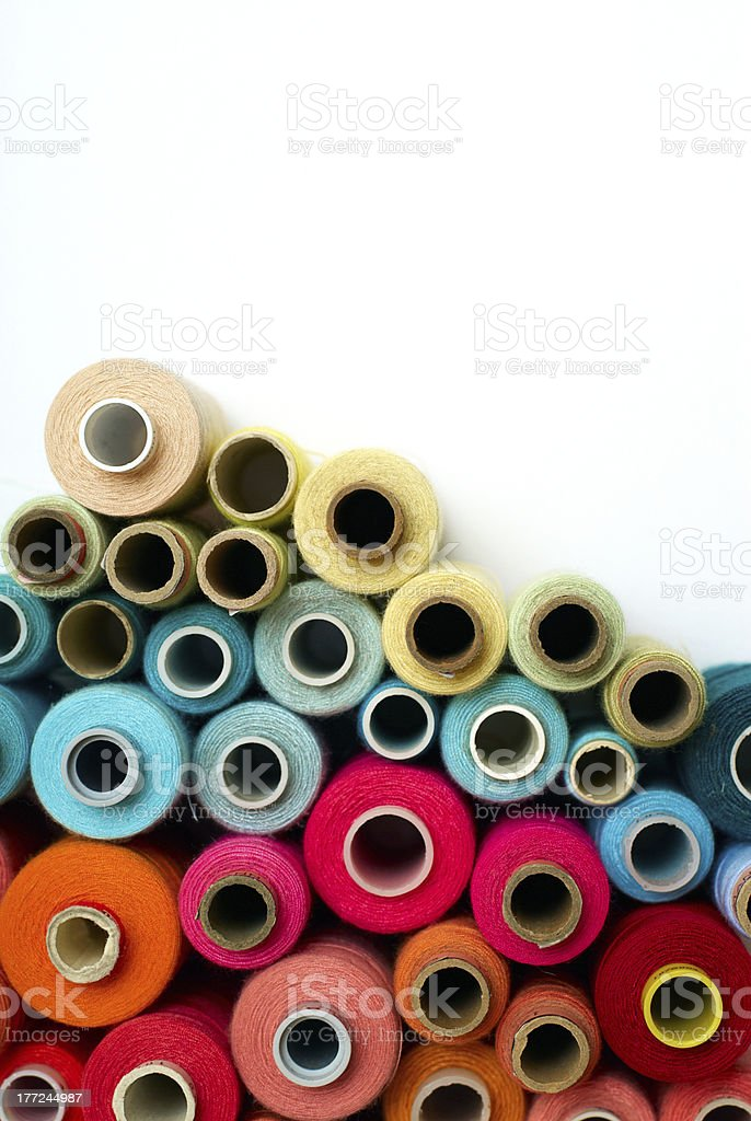 colored bobbins stock photo