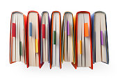 Books seen from above with bookmark on white background.