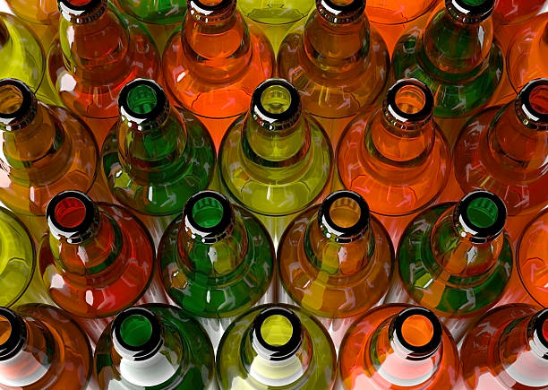 """colored bottles """"Empty beer bottles grouped, framed from above."""" bottle bank stock pictures, royalty-free photos & images"""