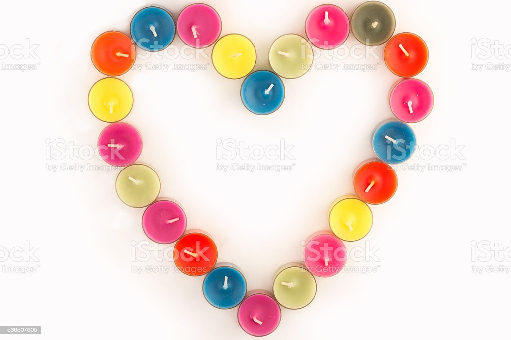 colored candle heart stock photo