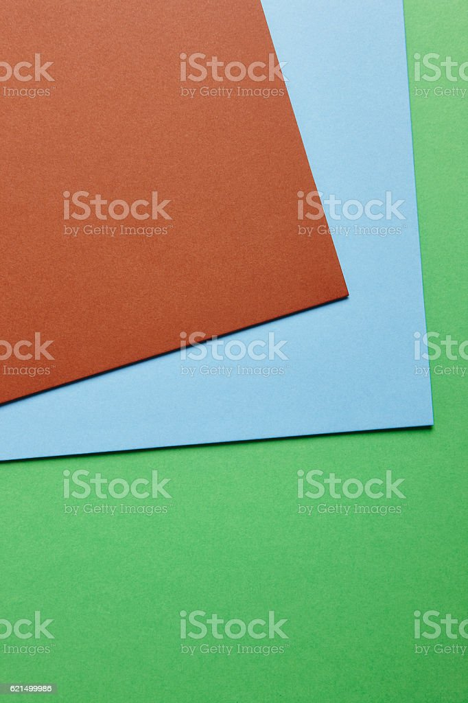 Colored cardboards background in beige blue yellow tone. Copy sp foto stock royalty-free