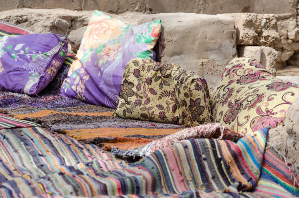colored carpets and pillows in a Bedouin village in Egypt Dahab South Sinai stock photo