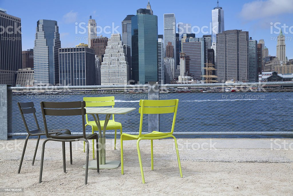 Colored chairs in front of Manhattan and east river royalty-free stock photo