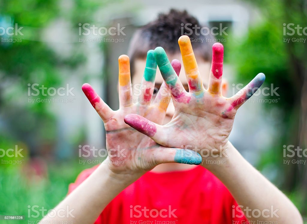 Colored child's hands stock photo