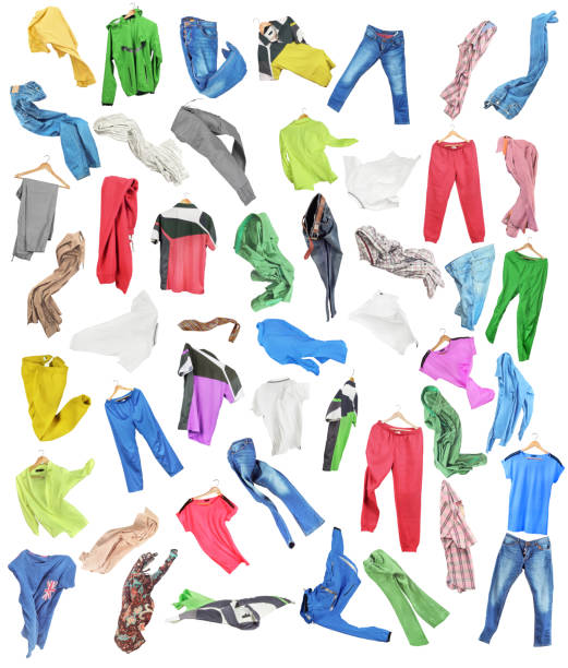 colored clothes in falling isolated on white background - garment stock photos and pictures