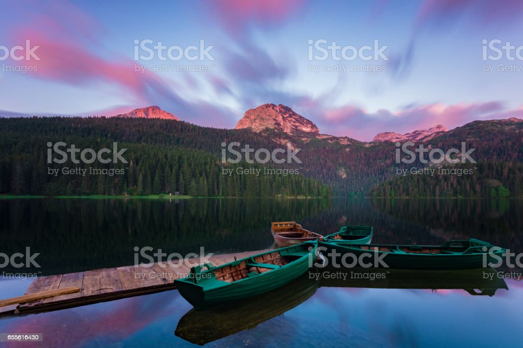 colored clouds in the morning on the lake Black in the national park Durmitor, Montenegro stock photo