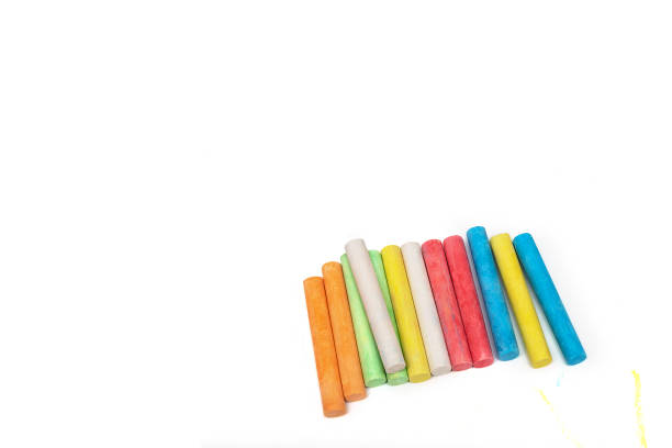 Colored crayons on a white sheet of paper. stock photo