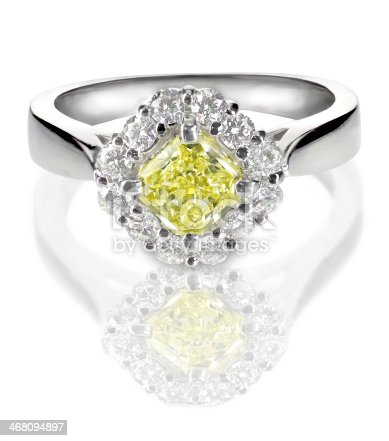 istock Colored diamond canary yellow in halo setting engagement wedding ring 468094897