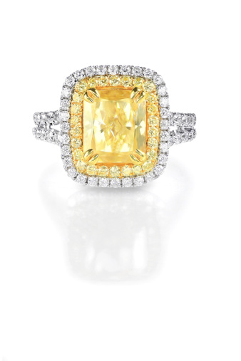 Three tone yellow canary diamond engagement ring with a double halo setting.A beautiful diamond brilliant princess cut stone is set sideways to create unique style set in white gold or platinum surrounded by beautiful round diamonds.