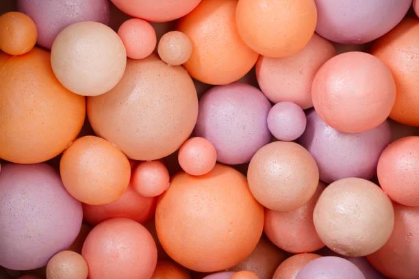 Colored different size styrofoam balls stock photo