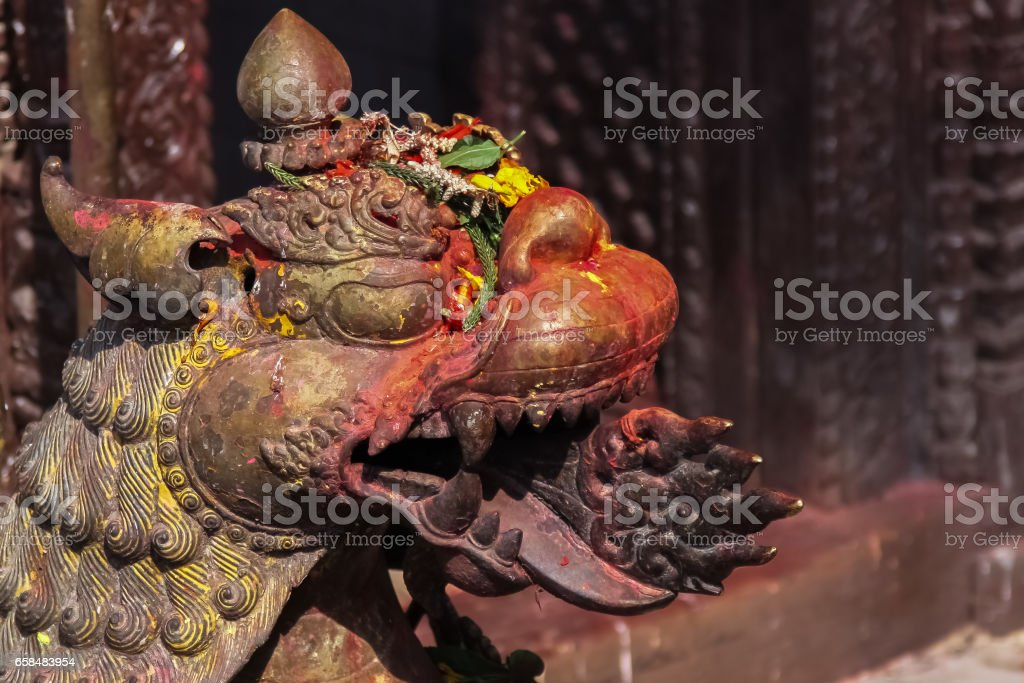 Colored Dragon head guarding Tal Barahi Temple, Lake Phewa, Pokhara stock photo
